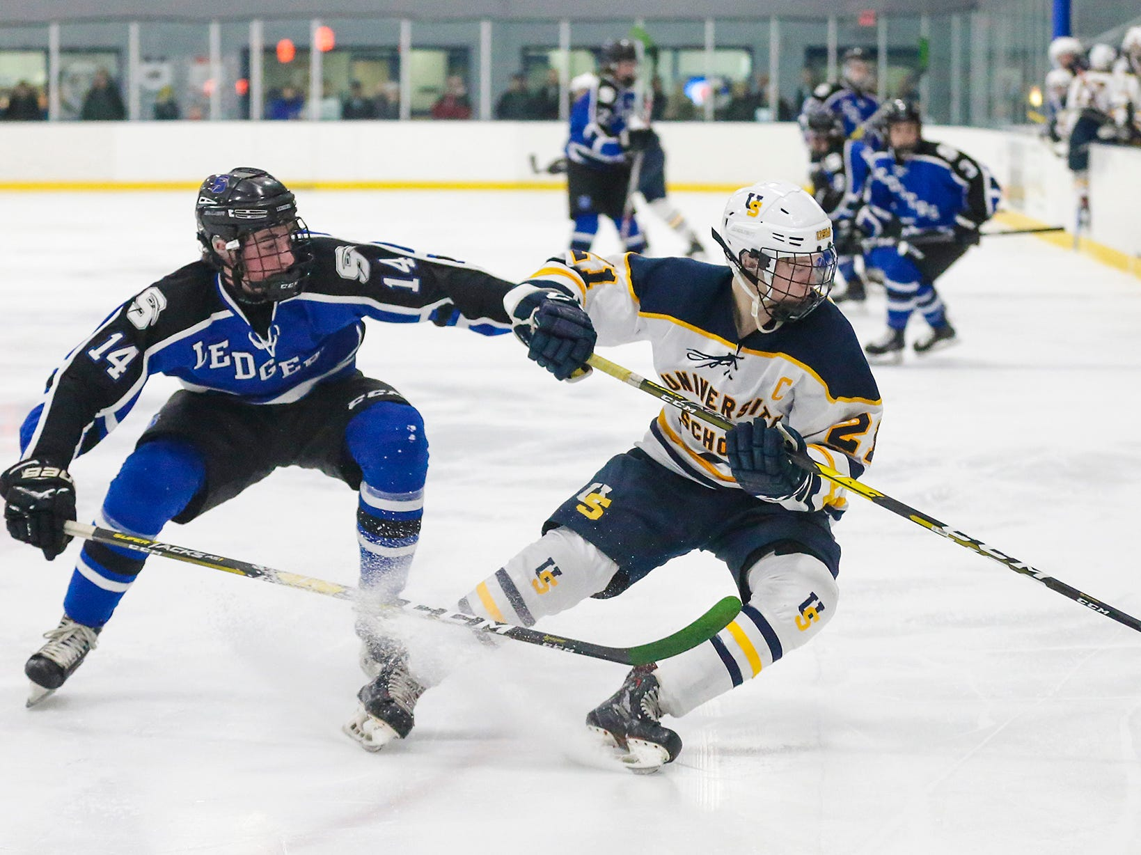 St. Mary's Springs boys co-op hockey's Connor McLaughlin (14) defends against University School of Milwaukee's Casey Roepke (21) Friday, February 22, 2019 during their WIAA sectional final game in Fond du Lac. University School won the game 6-1 and will advance to state. Doug Raflik/USA TODAY NETWORK-Wisconsin