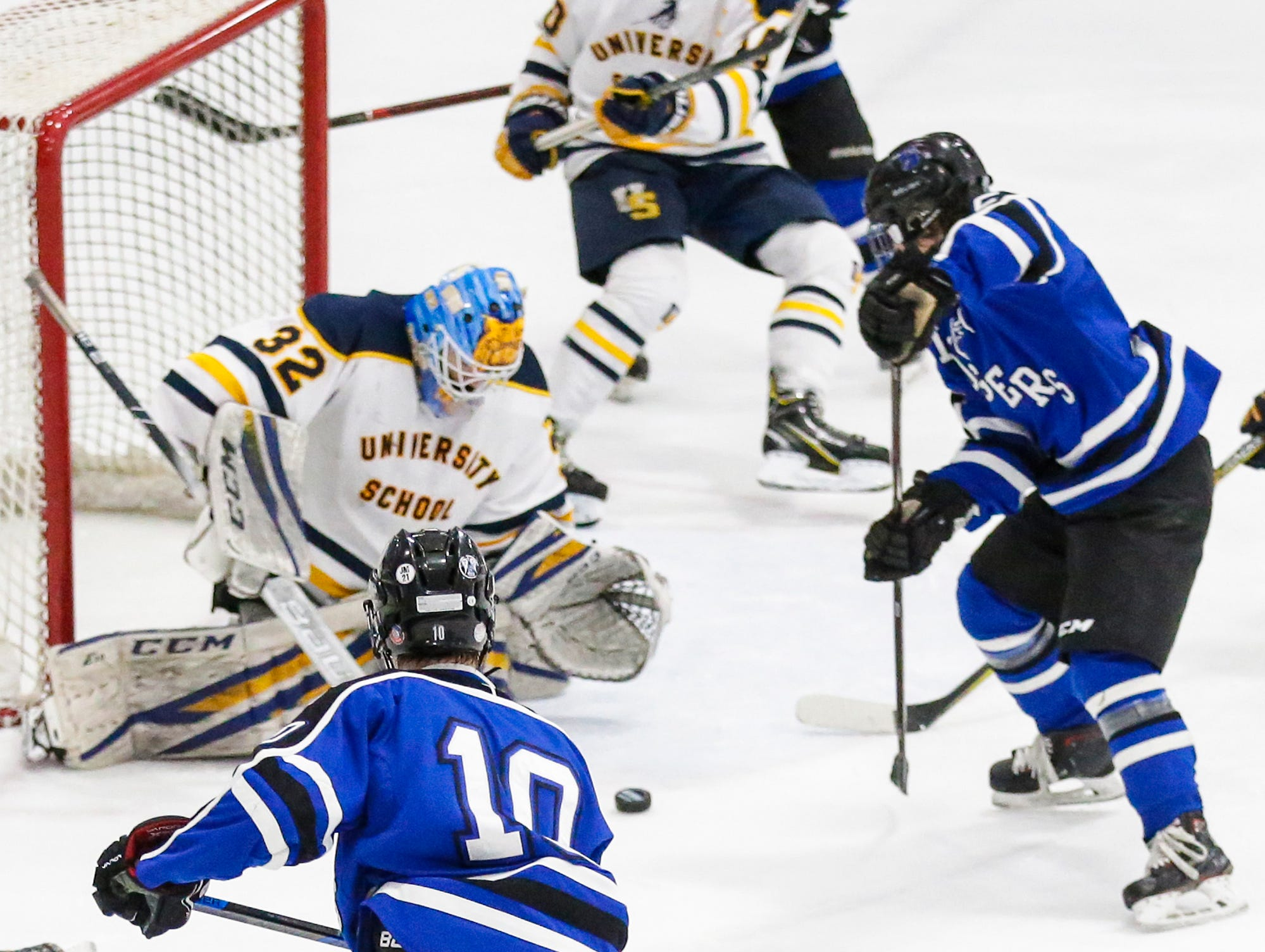 St. Mary's Springs boys co-op hockey's Dayne Deanovich (10) and Brady Welsch (5) try to get the puck past University School of Milwaukee goalie Patrick Kelly Friday, February 22, 2019 during their WIAA sectional final game in Fond du Lac. University School won the game 6-1 and will advance to state. Doug Raflik/USA TODAY NETWORK-Wisconsin