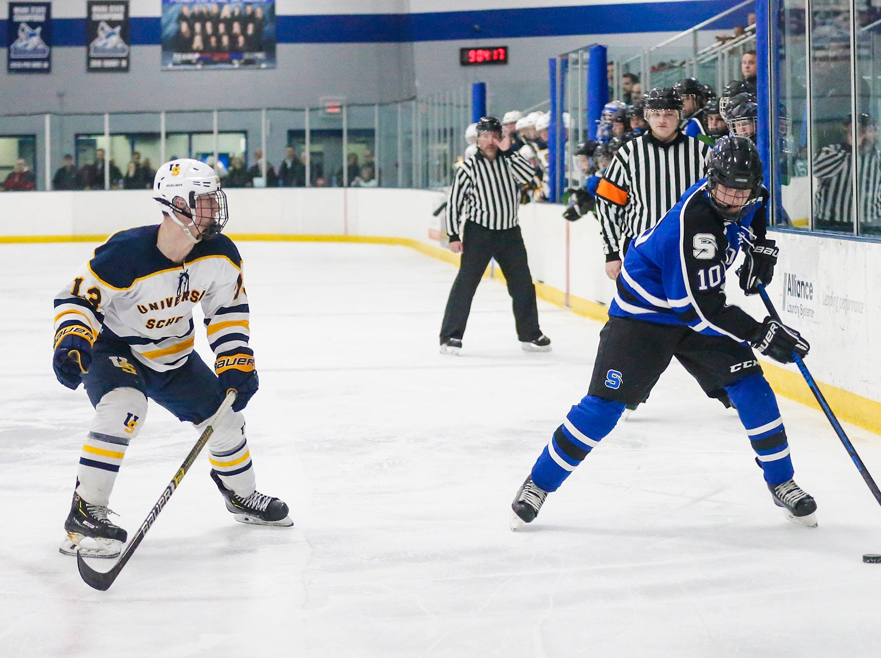 St. Mary's Springs boys co-op hockey's Dayne Deanovich (10) moves the puck against University School of Milwaukee's Robby Newton (13) Friday, February 22, 2019 during their WIAA sectional final game in Fond du Lac. University School won the game 6-1 and will advance to state. Doug Raflik/USA TODAY NETWORK-Wisconsin