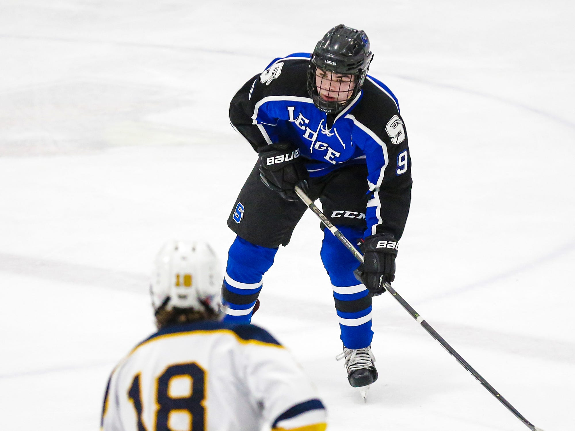 St. Mary's Springs boys co-op hockey's Noah Blanck (9) is defended by University School of Milwaukee's TJ Fenton (18) Friday, February 22, 2019 during their WIAA sectional final game in Fond du Lac. University School won the game 6-1 and will advance to state. Doug Raflik/USA TODAY NETWORK-Wisconsin