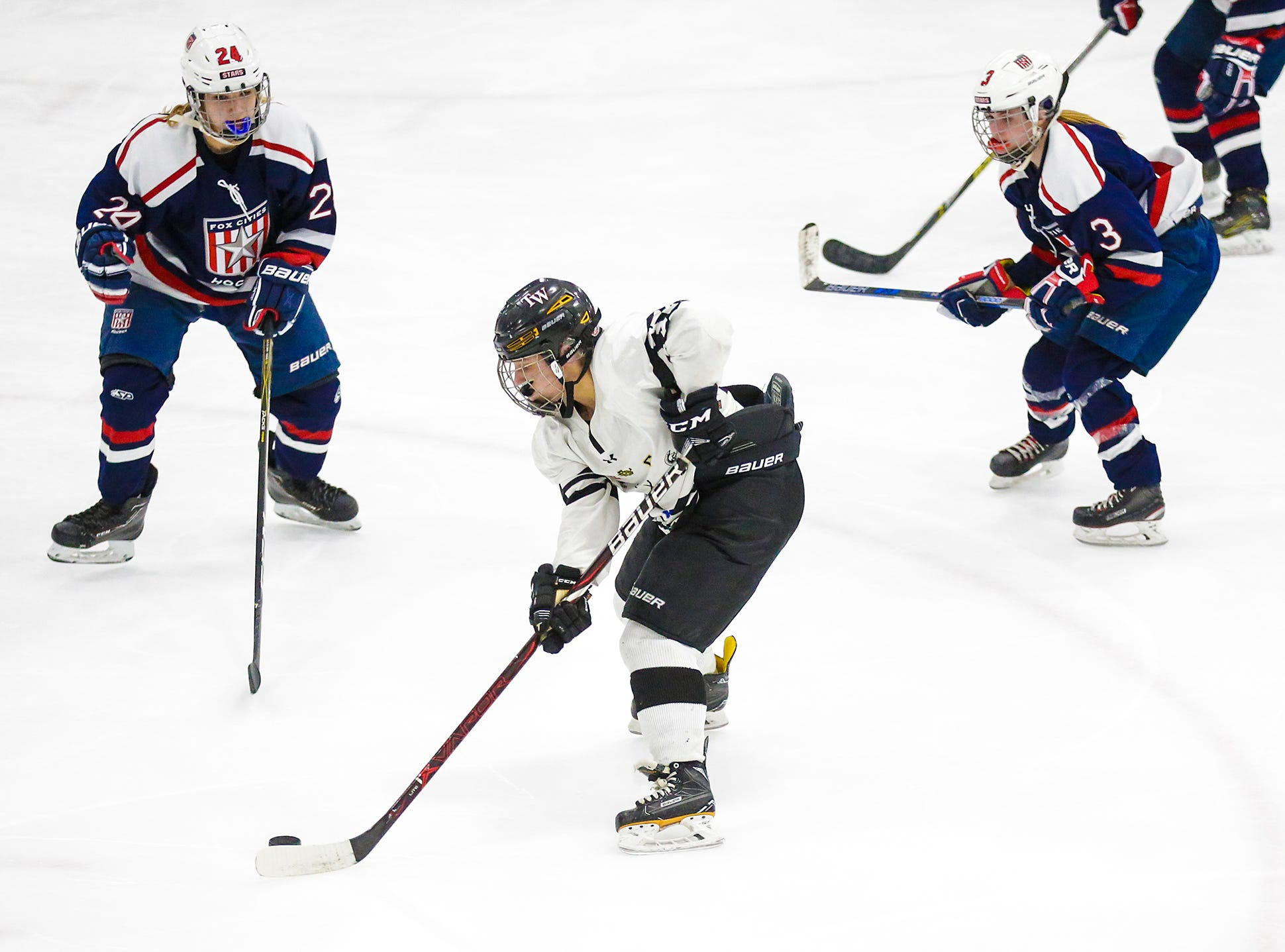 Beaver Dam Alliance girls hockey's Alyssa Heim (37) works the puck against the Fox Cities Stars' Hanna Hiltunen (24) and Shelby Hewitt (3) Friday, February 22, 2019 during their WIAA sectional final game in Fond du Lac. Fox Cities Stars won the game 5-2 and will advance to state. Doug Raflik/USA TODAY NETWORK-Wisconsin