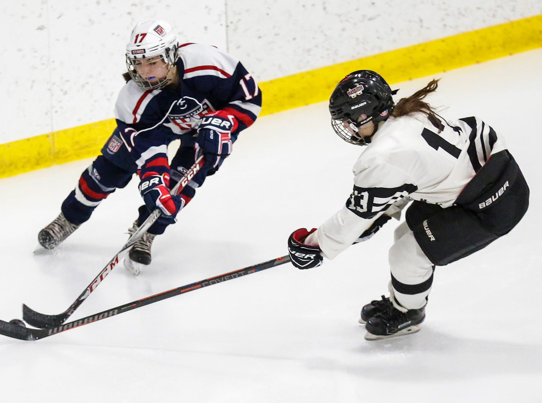 Fox Cities Stars girls hockey's Morgan Treml (17) and Beaver Dam Alliance's Maike Zipp (13) battle for the puck Friday, February 22, 2019 during their WIAA sectional final game in Fond du Lac. Fox Cities Stars won the game 5-2 and will advance to state. Doug Raflik/USA TODAY NETWORK-Wisconsin