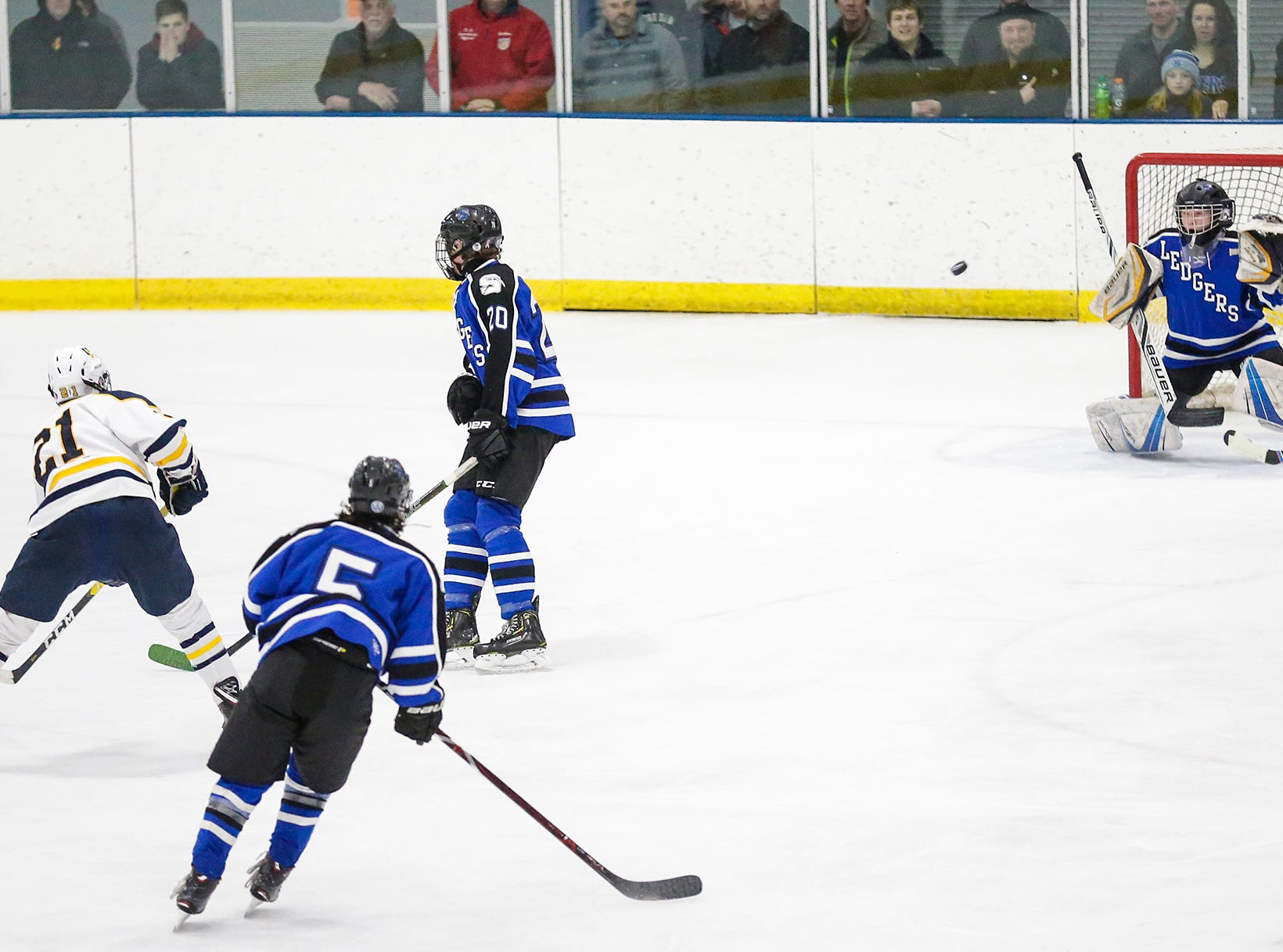 St. Mary's Springs boys co-op hockey's Joey Koleno gets in position to stop a puck hit by University School of Milwaukee's Casey Roepke Friday, February 22, 2019 during their WIAA sectional final game in Fond du Lac. University School won the game 6-1 and will advance to state. Doug Raflik/USA TODAY NETWORK-Wisconsin