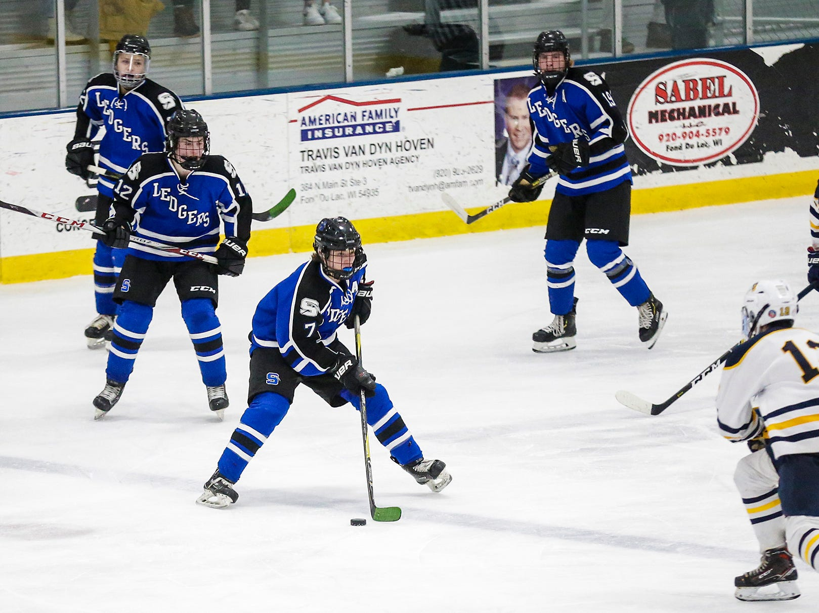 St. Mary's Springs boys co-op hockey's Jack Sabel (7) controls the puck against University School of Milwaukee Friday, February 22, 2019 during their WIAA sectional final game in Fond du Lac. University School won the game 6-1 and will advance to state. Doug Raflik/USA TODAY NETWORK-Wisconsin