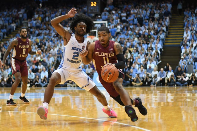 Florida State senior guard David Nichols (11) drives through North Carolina's defense during at the Dean E. Smith Center on February, 23, 2019.