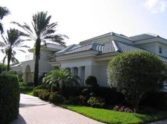 Bonita Springs home of Robert and Kay Gow, convicted of fraud and other charges in federal court Friday. The Gows have received a foreclosure notice on the property, which they bought for $1.6 mlllion in 1998. Prosecutors say the  $11,000 per month mortgage was paid  with Lee County tax dollars through a money laundering scheme.
