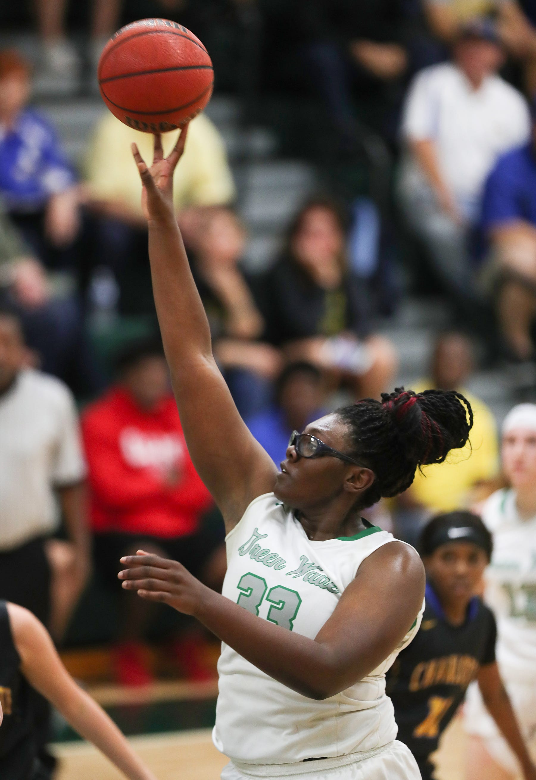 Fort Myers High School's Chaniya Clark scores against Charlotte on Friday in the Class 7A regional championship at Fort Myers. Fort Myers beat Charlotte 50-37.