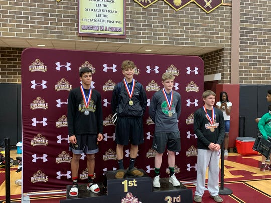 Mariner's Ethan Duke reached the top of  podium after winning the  Class 2A-District 11 132-pound championship at Riverdale High on Saturday