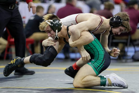 Coleman's Koltin Grzybowski tries to flip Fennimore's Luke Blair in a Division 3 113-pound weight class semifinal match during the WIAA state individual wrestling tournament Friday at the Kohl Center in Madison.