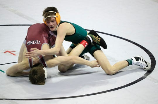 Ashwaubenon's Cody Minor wrestles Holmen's Alex Pellowski in a Division 1 113-pound semifinal match at the WIAA state individual wrestling tournament at the Kohl Center in Madison.