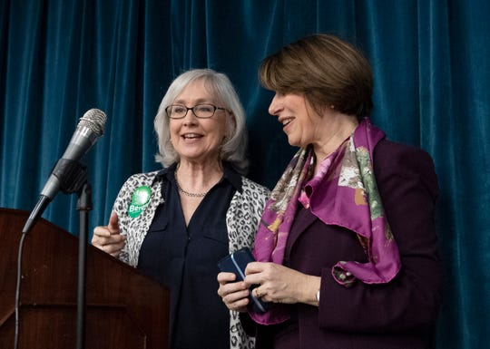 Kate Franch (left), the county chair of the Greenville County Democratic Party, and Sen. Amy Klobuchar stand on stage during the Greenville County Democratic Party's monthly breakfast held at Upstate Circle of Friends Saturday, Feb. 23, 2019.