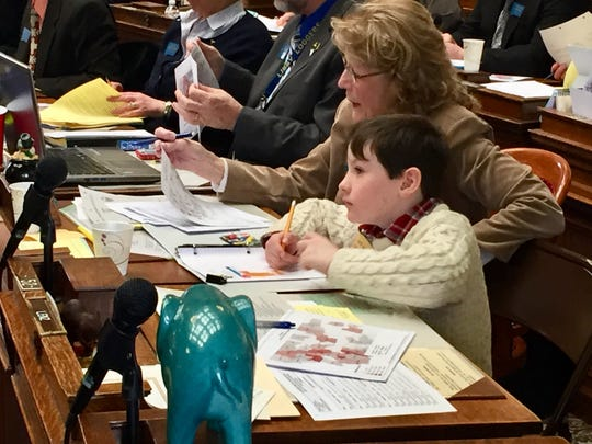 Rep. Nancy Ballance sits with grandson Jack on the House floor during the 2017 session.