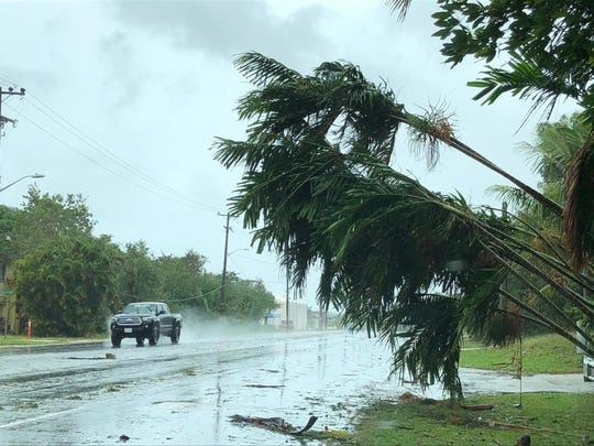 High winds and rains knocked down trees and flooded streets.