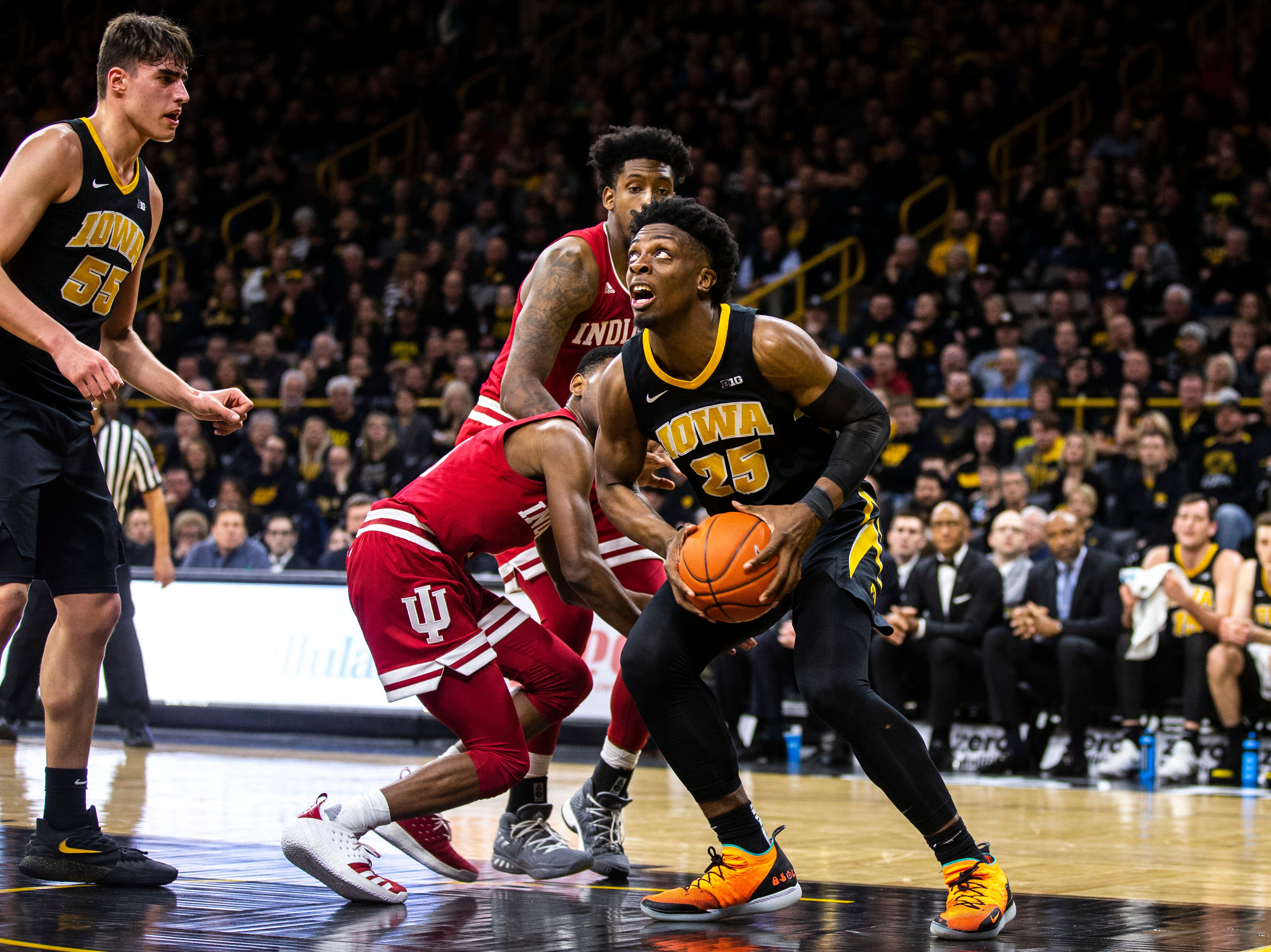 Iowa forward Tyler Cook (25) drives to the basket during a NCAA Big Ten Conference men's basketball game on Friday, Feb. 22, 2019 at Carver-Hawkeye Arena in Iowa City, Iowa.