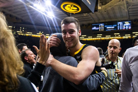 Iowa guard Connor McCaffery (30) hugs his brother Jack after a NCAA Big Ten Conference men's basketball game on Friday, Feb. 22, 2019 at Carver-Hawkeye Arena in Iowa City, Iowa.