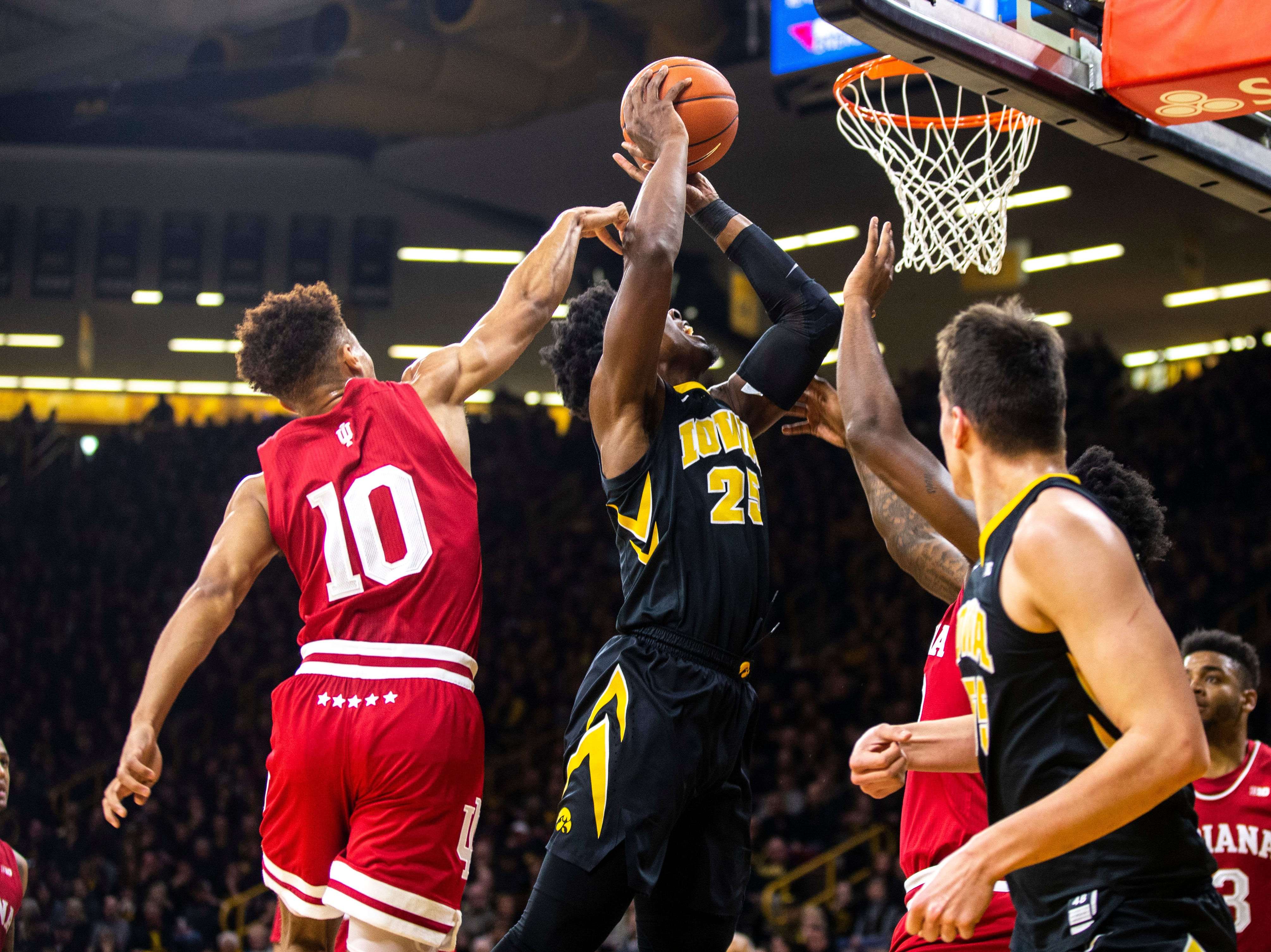 Iowa forward Tyler Cook (25) drives to the basket while Indiana guard Rob Phinisee (10) defends during a NCAA Big Ten Conference men's basketball game on Friday, Feb. 22, 2019 at Carver-Hawkeye Arena in Iowa City, Iowa.