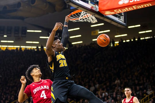 Iowa forward Tyler Cook (25) dunks while Indiana forward Jake Forrester (4) defends during a NCAA Big Ten Conference men's basketball game on Friday, Feb. 22, 2019 at Carver-Hawkeye Arena in Iowa City, Iowa.