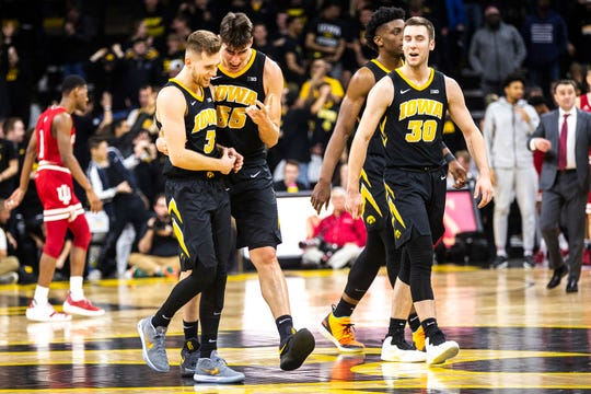 Iowa players including Luka Garza (55) and Jordan Bohannon (3) are calling it quits on Twitter after mounting fan criticism during a four-game losing streak.