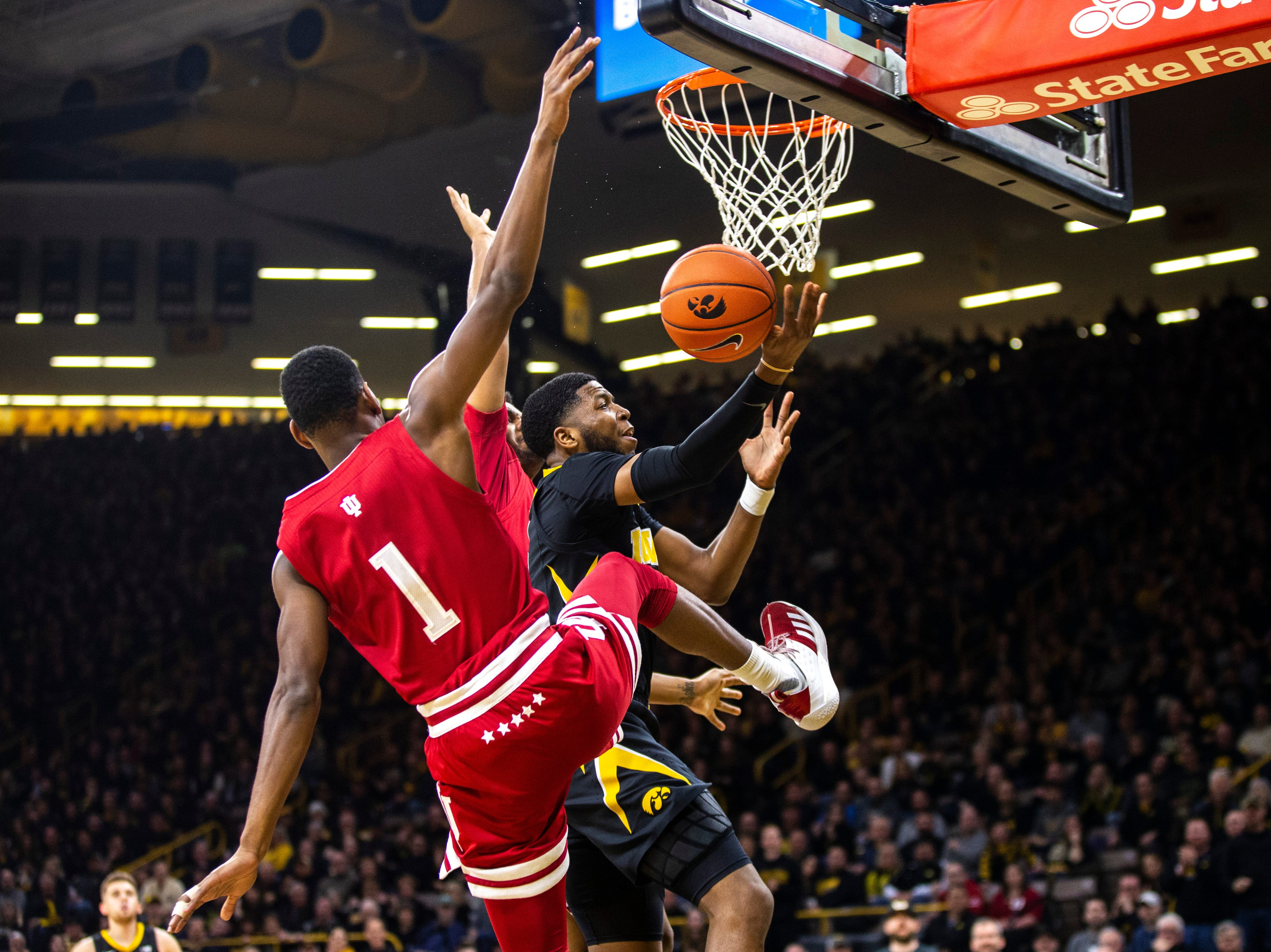 Iowa guard Isaiah Moss (4) drives to the basket while Indiana guard Aljami Durham (1) defends during a NCAA Big Ten Conference men's basketball game on Friday, Feb. 22, 2019 at Carver-Hawkeye Arena in Iowa City, Iowa.