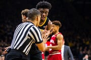Iowa forward Tyler Cook (25) talks with an official during a NCAA Big Ten Conference men's basketball game on Friday, Feb. 22, 2019 at Carver-Hawkeye Arena in Iowa City, Iowa.