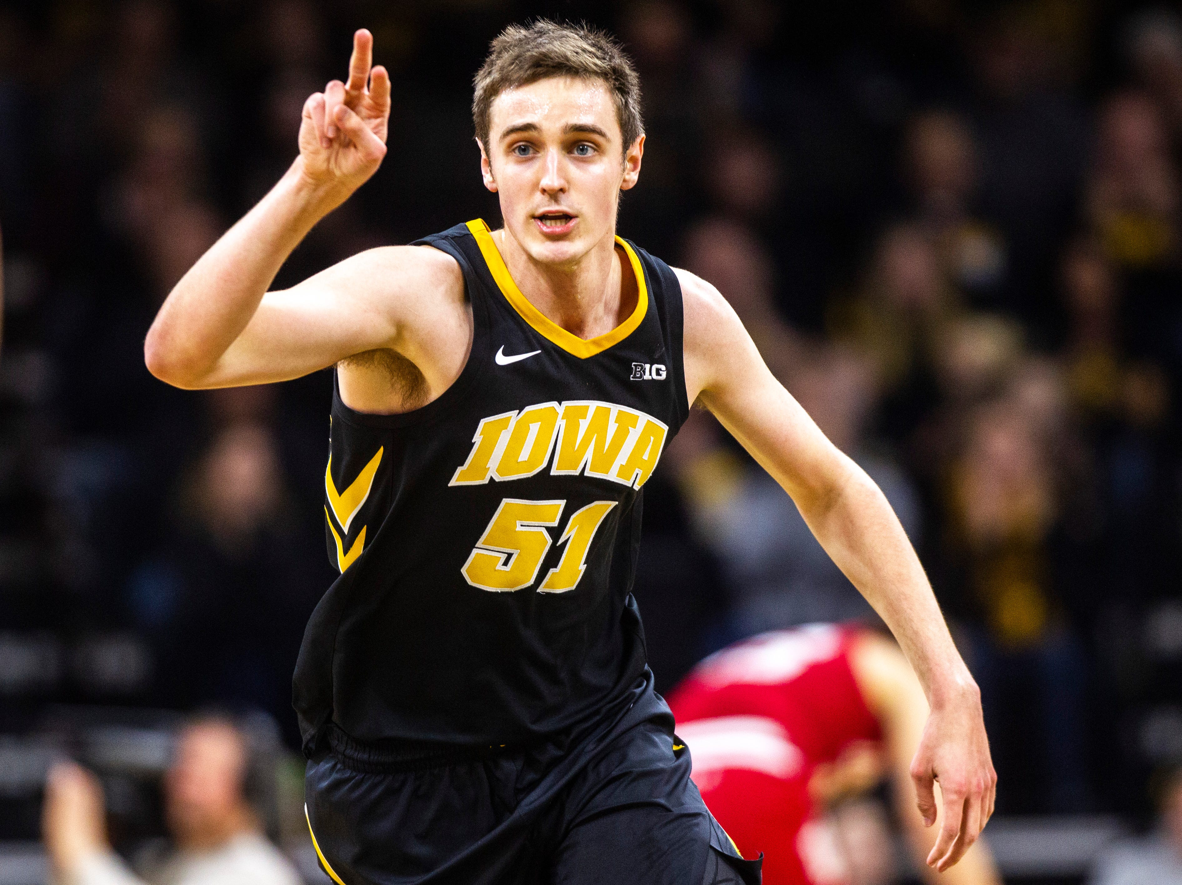 Iowa forward Nicholas Baer (51) gestures to teammates after making a 3-point basket during a NCAA Big Ten Conference men's basketball game on Friday, Feb. 22, 2019 at Carver-Hawkeye Arena in Iowa City, Iowa.
