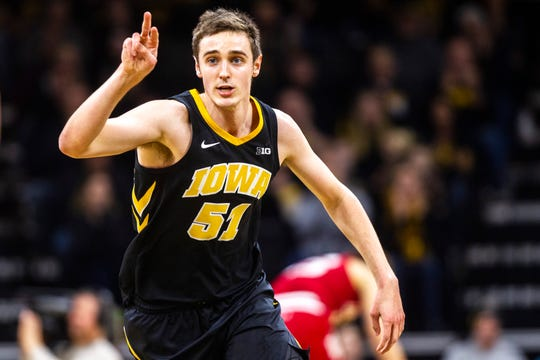 How many times have you seen this, Hawkeye fans? Nicholas Baer gestures to teammates and hustles up the floor after making a 3-pointer vs. Indiana on Feb. 22. Baer will be playing his final game at Carver-Hawkeye Arena on Saturday.