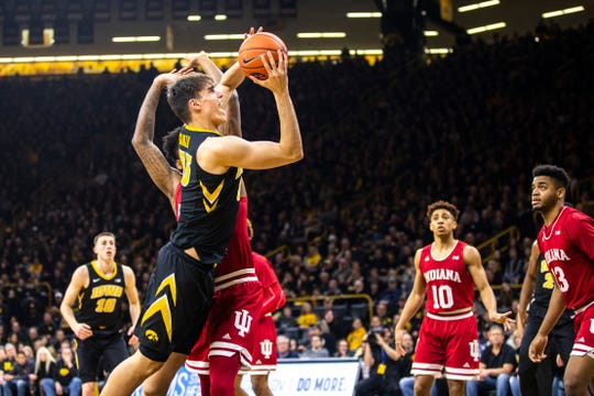 Iowa center Luka Garza, shown here driving against Indiana last season, averaged 13.1 points on 53.1 percent shooting as a sophomore. His goals for his junior year including being more of a physical presence inside on defense.