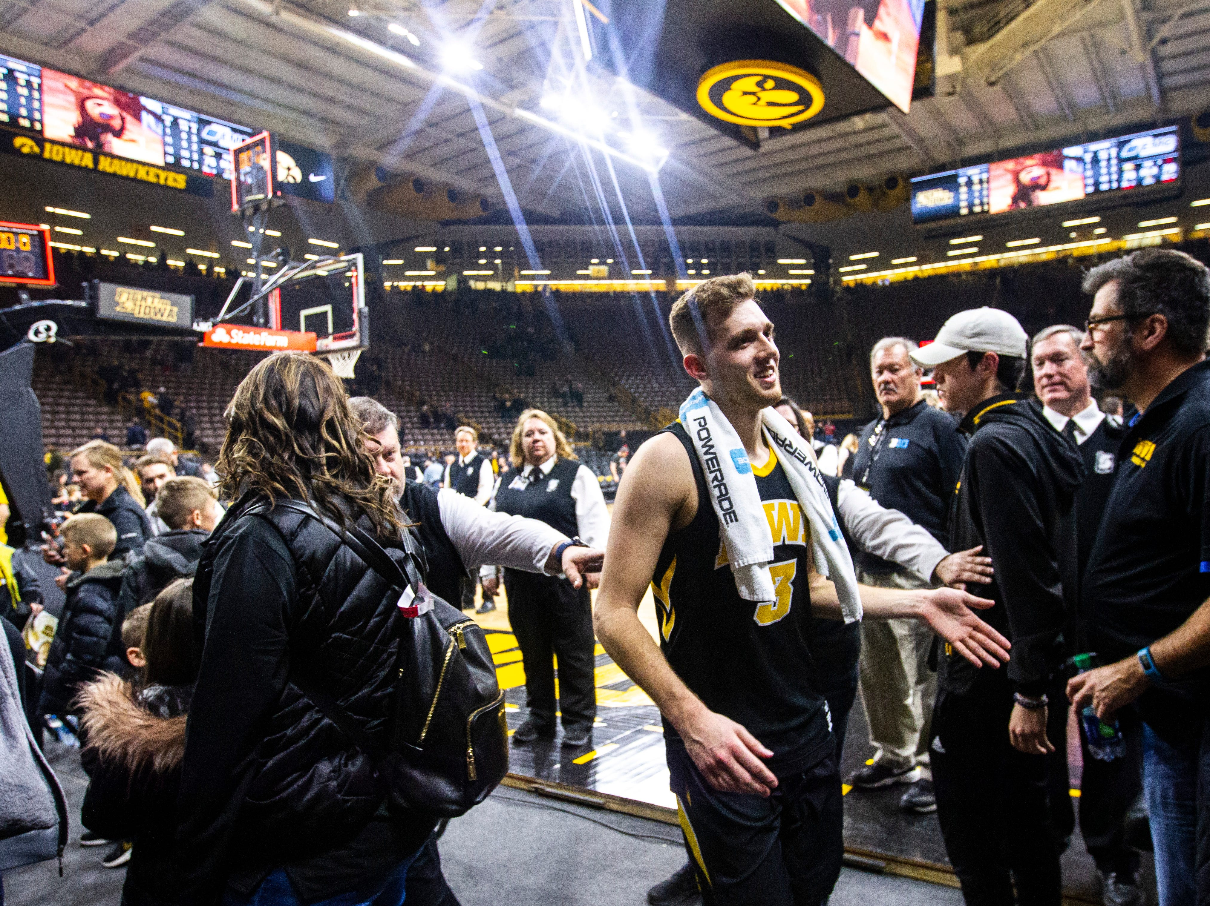 Iowa guard Jordan Bohannon (3) high-fives fans after a NCAA Big Ten Conference men's basketball game on Friday, Feb. 22, 2019 at Carver-Hawkeye Arena in Iowa City, Iowa.