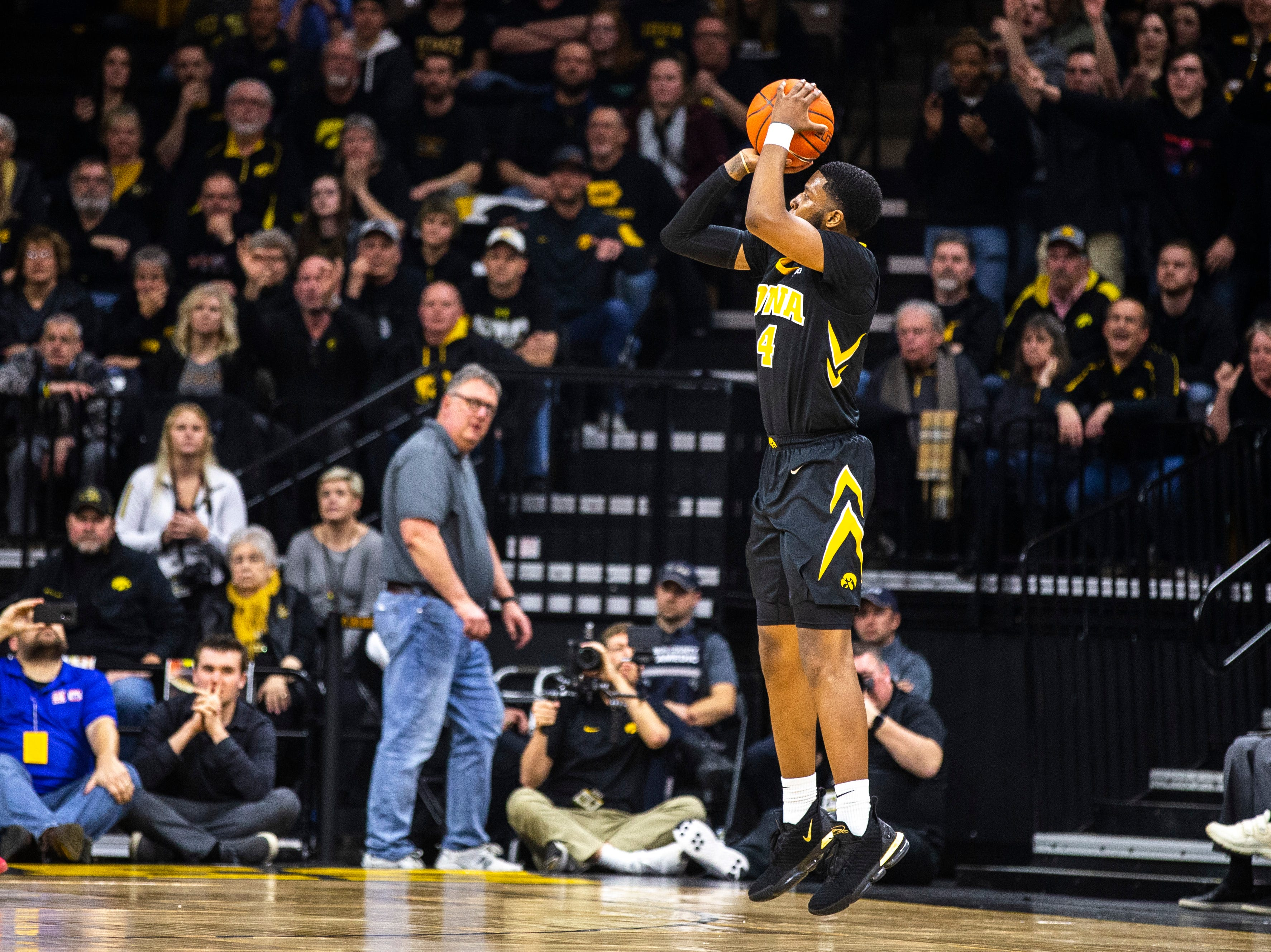 Iowa guard Isaiah Moss (4) attempts a 3-point basket during a NCAA Big Ten Conference men's basketball game on Friday, Feb. 22, 2019 at Carver-Hawkeye Arena in Iowa City, Iowa.