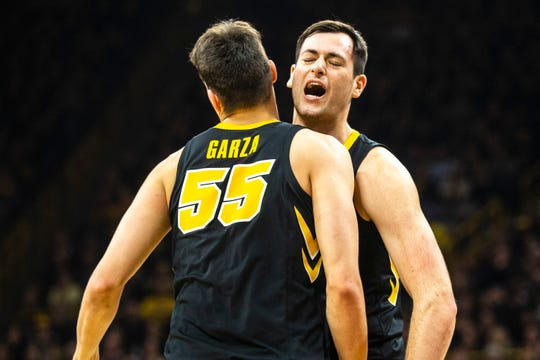 "Ryan Kriener (right, chest-bumping teammate Luka Garza) says a ""never say die attitude"" has been with this Hawkeye team throughout the offseason."