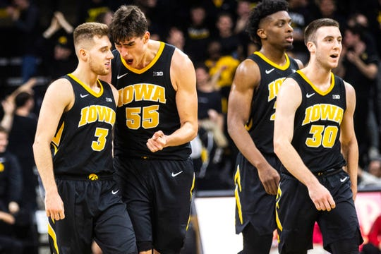 Iowa basketball players Jordan Bohannon (from left), Luka Garza, Tyler Cook and Connor McCaffery say there is a better connection on the team this season. It has shown in the win-loss record. The Hawkeyes are 22-11 entering NCAA Tournament play, an improvement of eight wins from a year ago.