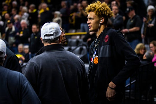 Oskaloosa forward Xavier Foster talks with Iowa assistant Sherman Dillard before a NCAA Big Ten Conference men's basketball game on Friday, Feb. 22, 2019 at Carver-Hawkeye Arena in Iowa City, Iowa.
