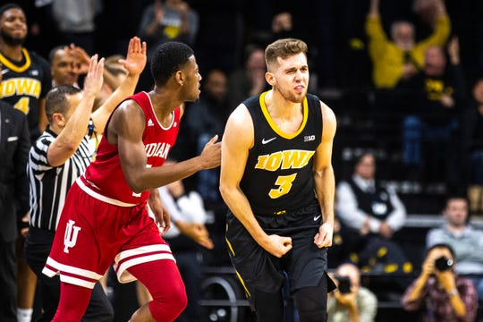 Iowa guard Jordan Bohannon (3) reacts after making a 3-point basket during a NCAA Big Ten Conference men's basketball game on Friday, Feb. 22, 2019 at Carver-Hawkeye Arena in Iowa City, Iowa.