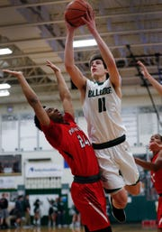 Monrovia's Josh Smith (11) drives on Park Tudor Panthers Kadaphi Honaker (24) in the first half of their game at Monrovia High School on Friday.