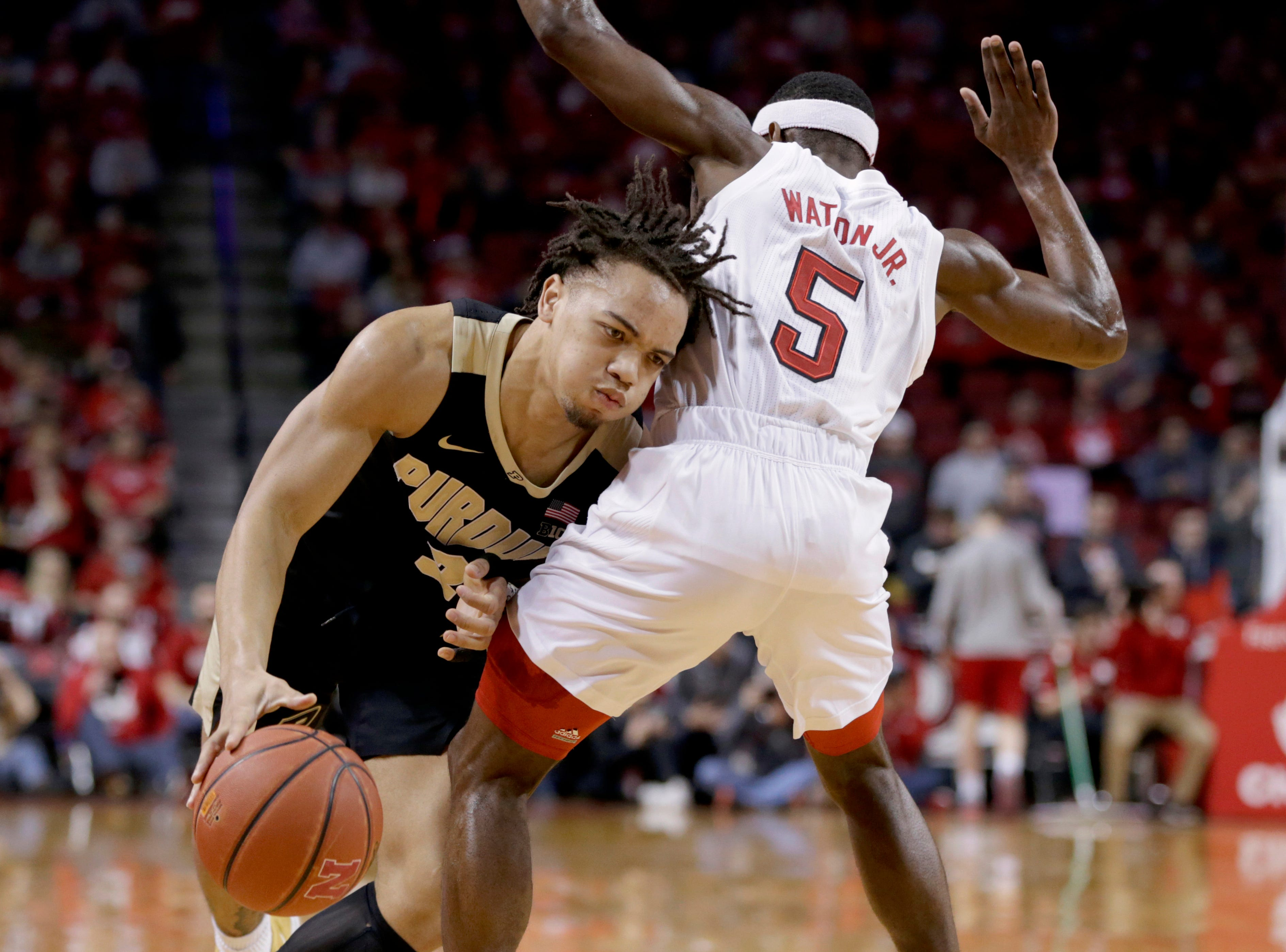 Purdue's Carsen Edwards (3) drives around Nebraska's Glynn Watson Jr. (5) during the first half of an NCAA college basketball game in Lincoln, Neb., Saturday, Feb. 23, 2019.