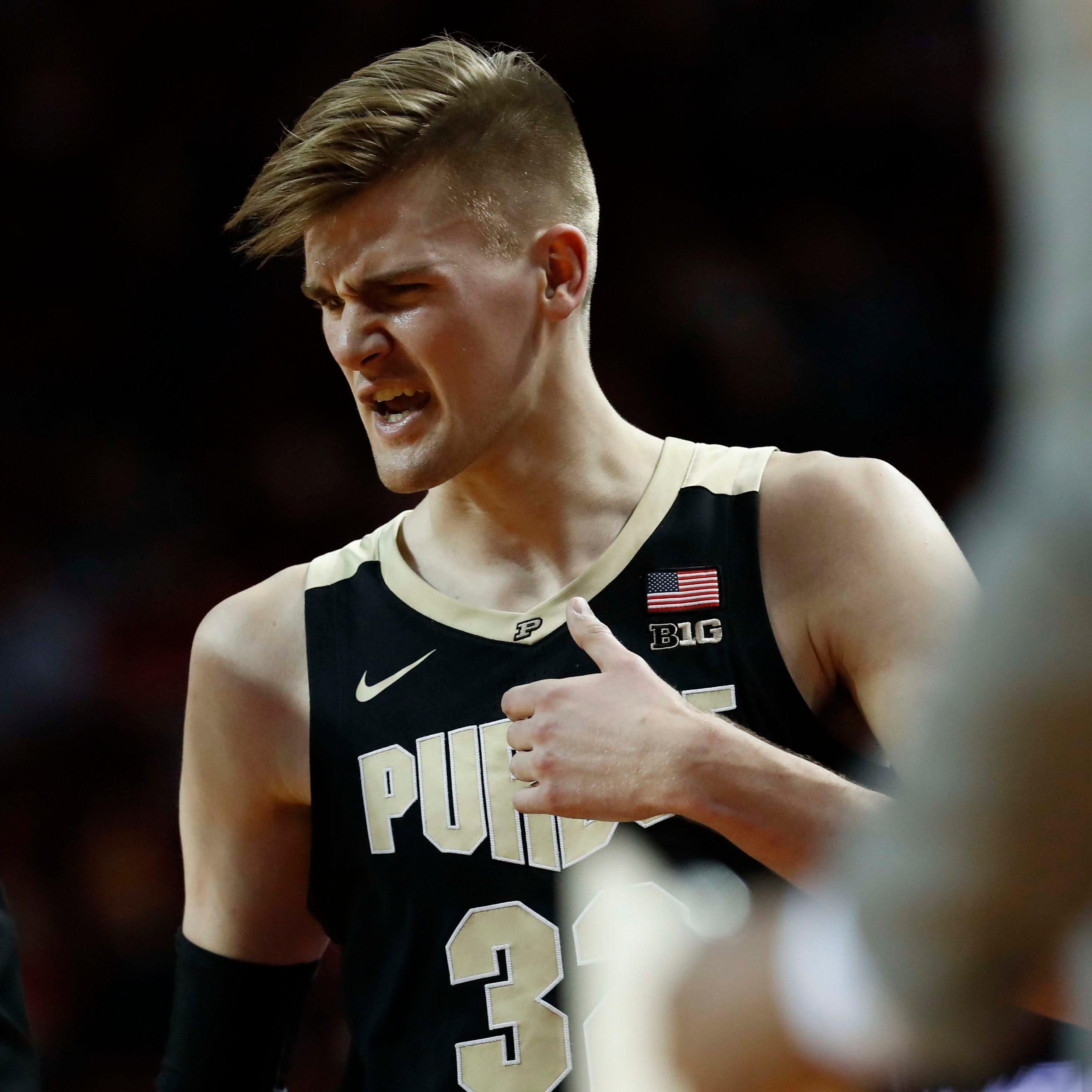 Minnesota fan confronts Matt Haarms as Gopher students storm court after beating Purdue