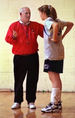 Bob Kirkhoff (left), the coach for the Roncalli Varsity Girls Basketball team, talks with player Jenna Hayes (right) at practice, Friday, Nov. 7, 1997.  FOR USE WITH STORY.  FILE #27712.  PHOTO BY KELLY WILKINSON