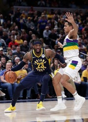 Indiana Pacers guard Wesley Matthews (23) drives on New Orleans Pelicans guard Frank Jackson (15) during the second half of an NBA basketball game in Indianapolis, Friday, Feb. 22, 2019. The Pacers won 126-111.