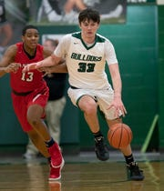 Monrovia Bulldogs Max Newman (33) talks the fast break by Park Tudor Panthers JC Green (13) in the first half of their game at Monrovia High School on Friday, Feb 22., 2018.