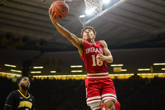 Indiana Hoosiers guard Rob Phinisee (10) goes to the basket as Iowa Hawkeyes guard Isaiah Moss (4) looks on during the first half at Carver-Hawkeye Arena.