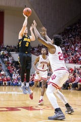 Feb 7, 2019; Bloomington, IN, USA; Iowa Hawkeyes guard Jordan Bohannon (3) shoots the ball over Indiana Hoosiers forward De'Ron Davis (20) in the second half at Assembly Hall. Mandatory Credit: Trevor Ruszkowski-USA TODAY Sports
