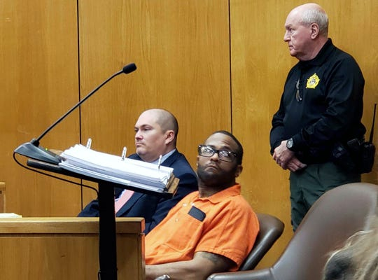 Willie Cory Godbolt, center, who is charged with killing eight people in May, 2017, looks around a Lincoln County Circuit Courtroom in Brookhaven, Miss., Friday, Feb. 22, 2019, as Circuit Judge David Strong, unseen, sets a February, 2020 trial date.