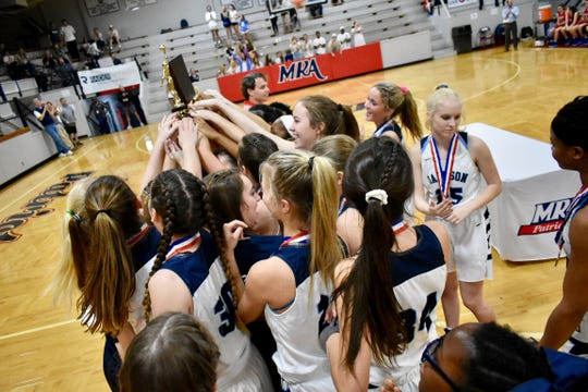 Jackson Academy celebrates with the championship trophy after beating Jackson Prep 18-15 Saturday, February 23, 2019, in the 4A-Divison I title game at Madison-Ridgeland Academy