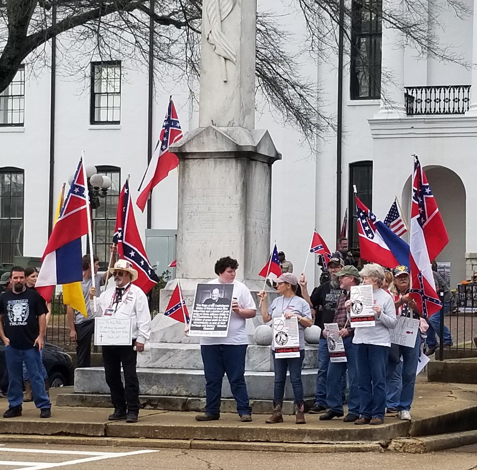 Scenes from pro-Confederate rally:  Group marches to Confederate memorial at Ole Miss