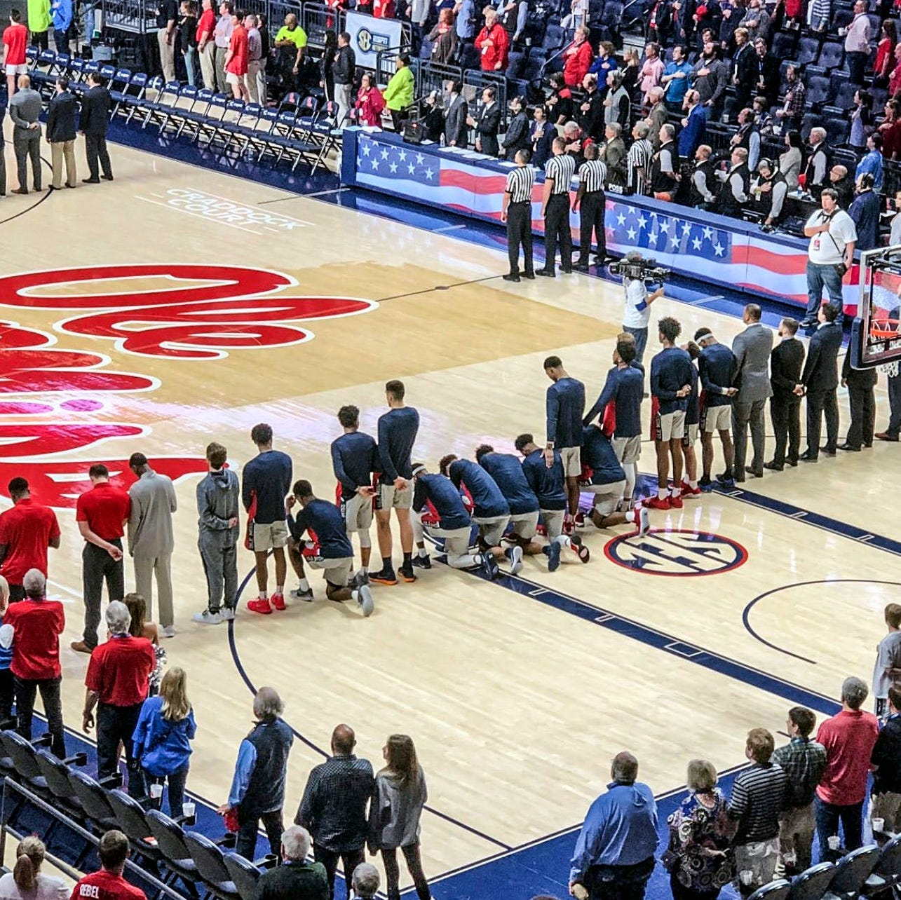 Twitter erupts after Ole Miss basketball players kneel during National Anthem