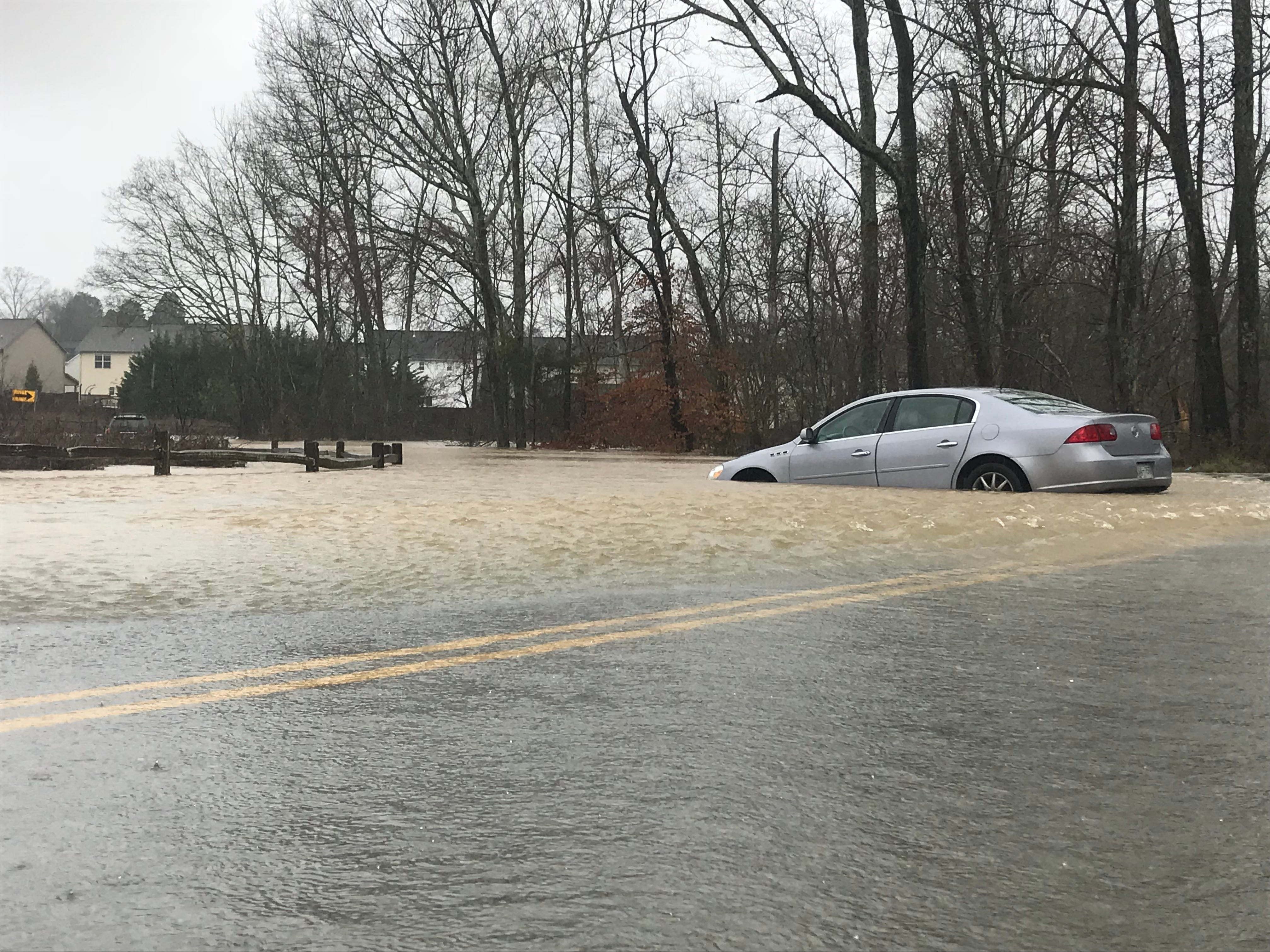 Brenda Colbert's Buick Lucerne became trapped in floodwaters Saturday on Harrell Road in Knoxville. She was rescue by the Karns Fire Department on Feb. 23, 2019.