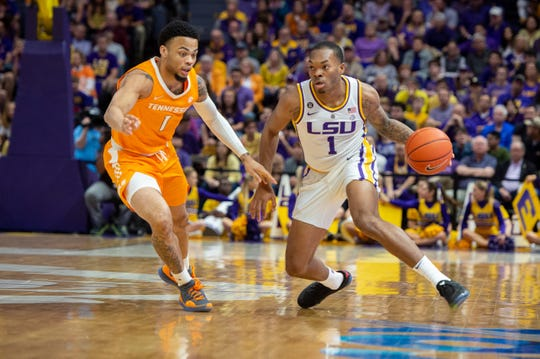 LSU's Javonte Smart dribbles up court as Tennessee's Lamonte Turner defends during an NCAA college basketball game, Saturday, Feb. 23, 2019, in Baton Rouge, La. (Scott Clause/The Daily Advertiser via AP)