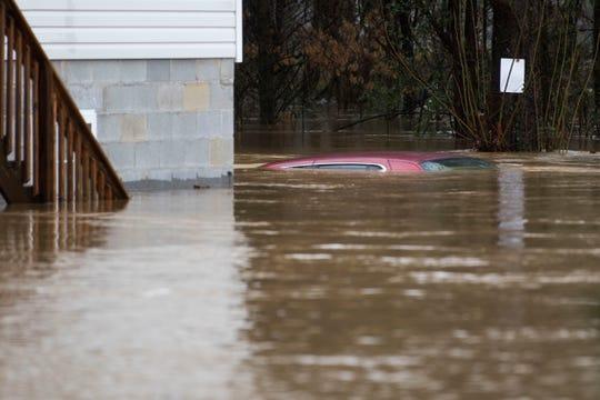 A car is submerged in Boyd's Creek in Boyds Creek Saturday Feb. 23, 2019.