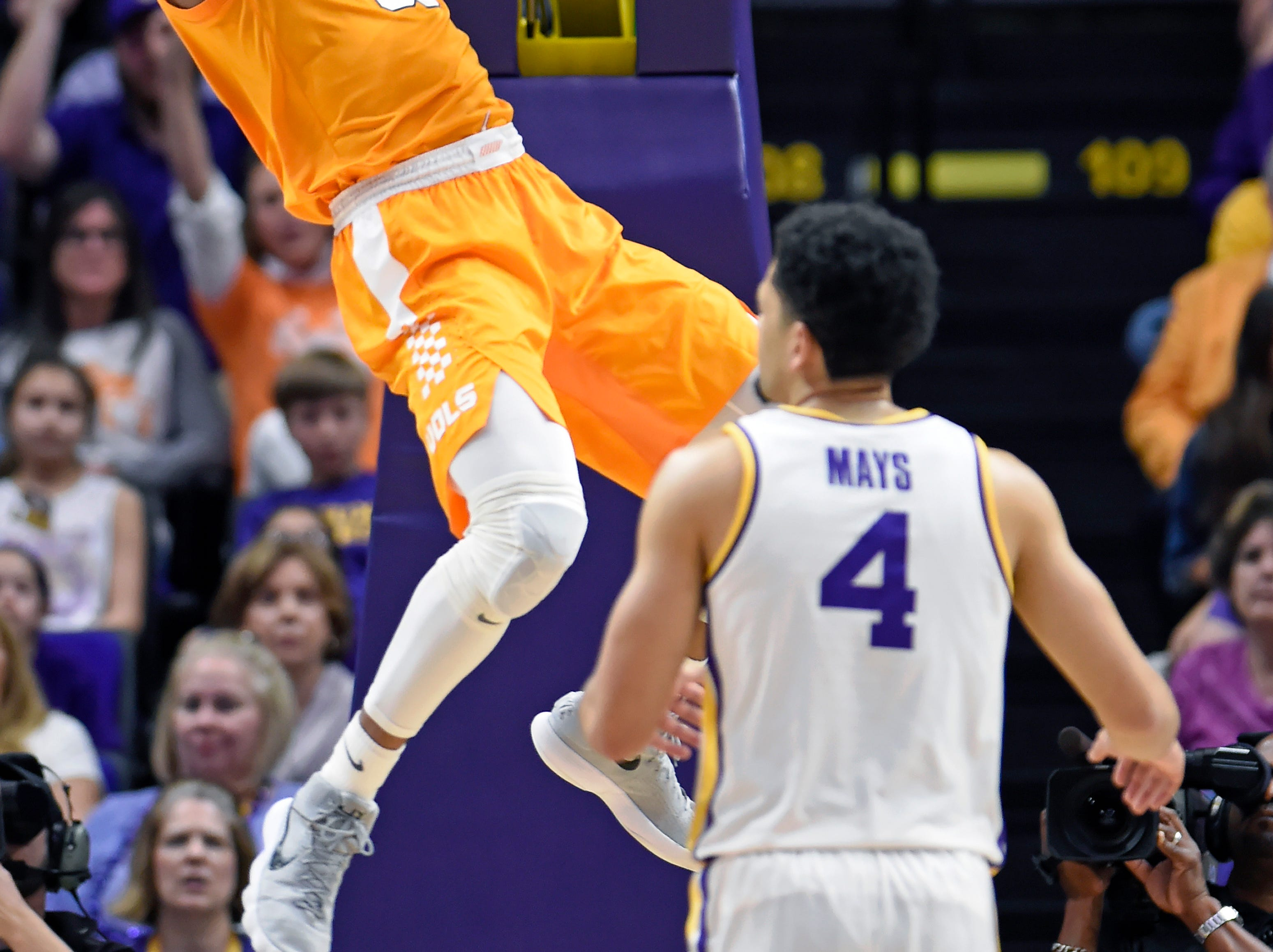 Tennessee guard Yves Pons (35) dunks the ball in front of LSU guard Skylar Mays (4) in the first half of an NCAA college basketball game, Saturday, Feb. 23, 2019, in Baton Rouge, La. (AP Photo/Bill Feig)