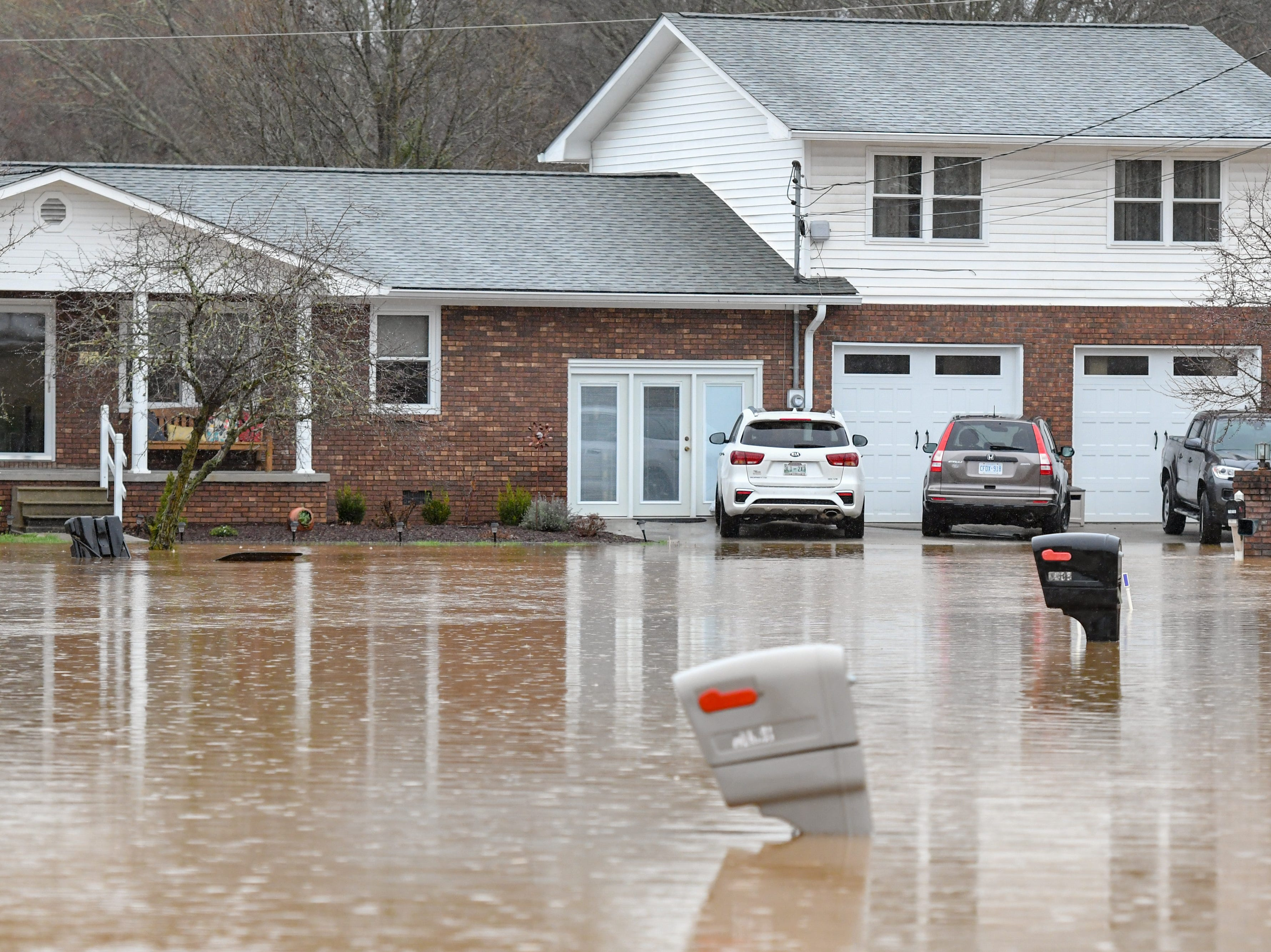 Flood waters on Lena Lane in Halls Saturday Feb. 23, 2019. The Knoxville area could see between 2 and 3 inches of rain through the weekend.